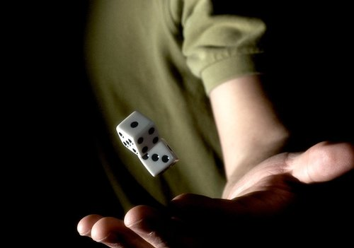 guy in a green shirt throwing dice